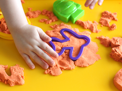 Cookie cutters on kinetic sand