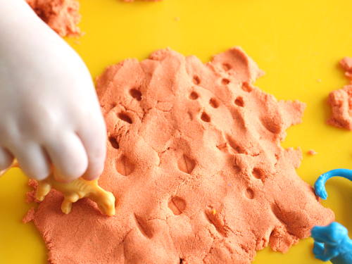 Dino tracks in kinetic sand