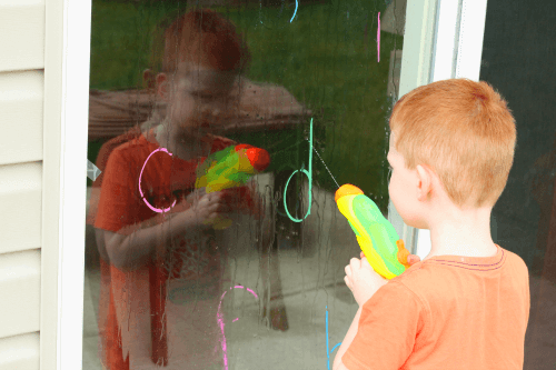 Preschool summer alphabet activity. Squirt the letter with a water gun!