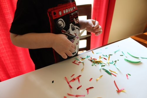 Cutting Practice: Make Ribbon Confetti. Gives scissor skills practice and reinforces fine motor development.