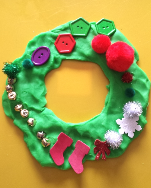 Invitation to Create a Wreath from Play Dough. A fun and festive way to develop fine motor skills and spark creativity!