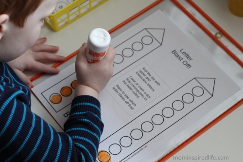 Letter Blast Off! Printable letter recognition game for preschoolers.