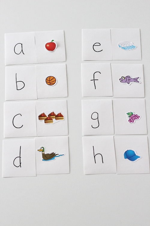 Beginning Sounds Matching Puzzles. Index cards cut in half with a sticker on one piece and a coordinating letter on the other piece.