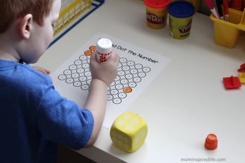 Roll and Dot the Number. Math game for kids that teaches number identification and counting.