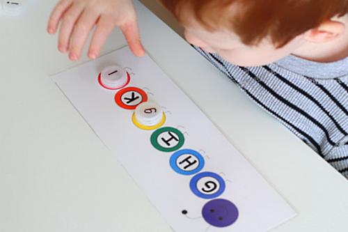 Match bottle caps with letters on them to letters on the caterpillar printable.