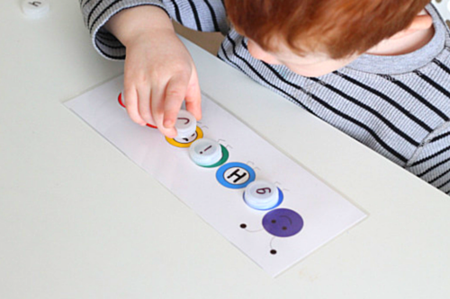 Match lowercase bottle cap letters to uppercase letters on the caterpillar printable cards.