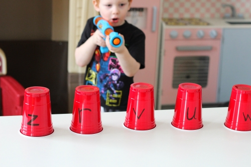Child should aim at the cups and shoot the ball at the cup the corresponds to the letter sound you call out