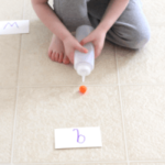 Blowing Pom Poms Alphabet Activity
