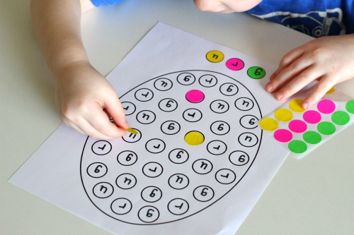 Match dot stickers to correct letter on the egg