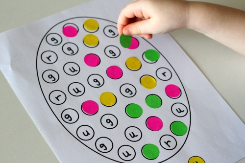 Use the key to match correct dot sticker to it's coordinating letter