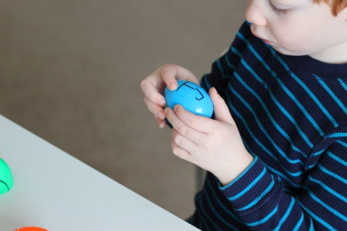 Child should put Easter eggs together so that the letter on each side of the egg is correctly formed