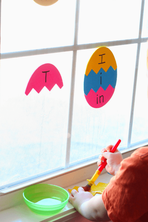 Paint the backs of the foam shapes with water and stick them to the window