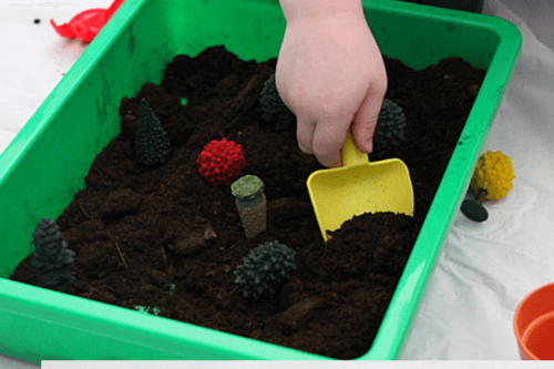 Dig in soil with shovel and pretend to plant trees