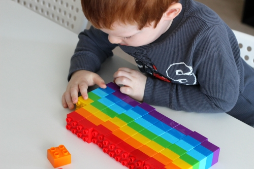 Put together 10 rainbow pattern towers and count the towers