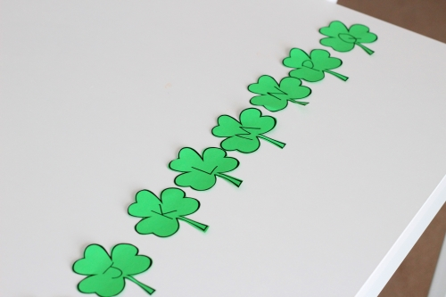 Write alphabet letters on shamrocks
