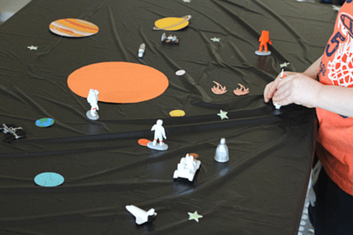 Use toys from the Space Toob to play on the space mat
