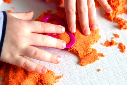 Remove cookie cutter so the kinetic sand letter remains