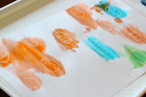Paint over white crayon and find eggs