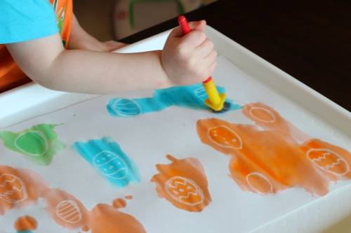 White crayon resists watercolor and the Easter eggs show up
