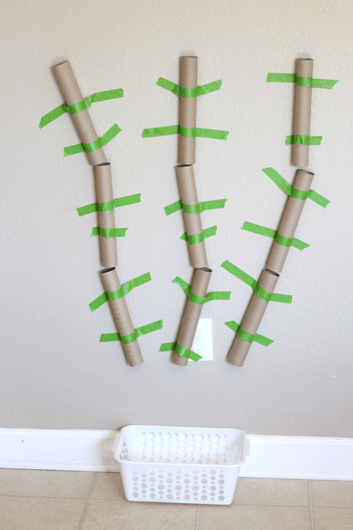 Make a word machine with paper towel tubes and tape.