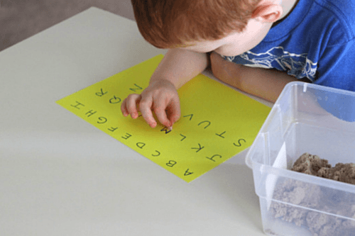 Match each letter bead to the letters written on the paper