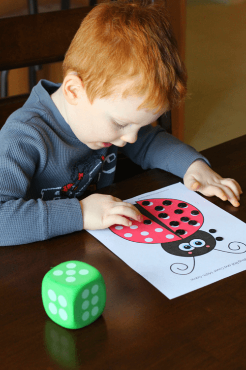 Roll dice and add numbers then cover that many spots with buttons