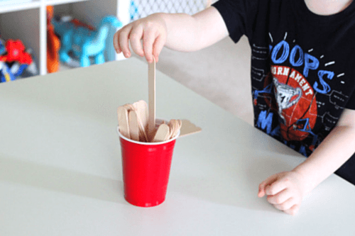 Pull a craft stick from the cup and tell the sound the letter makes
