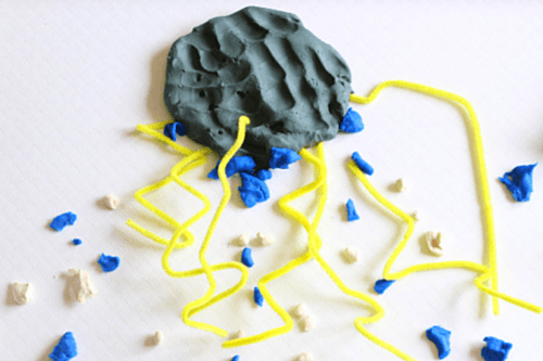 Add blue play dough raindrops and white play dough for hail.