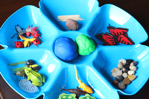 Invitation to make a pond with play dough.