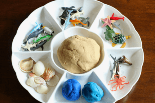 Combine sand play dough and ocean animals to make a fun ocean habitat!