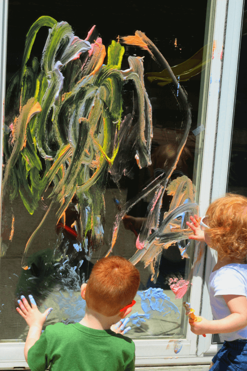 Make a colorful painting on your sliding glass door with shaving cream paint!