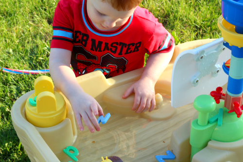 Find the letters in the water table and put them back in the puzzle board.