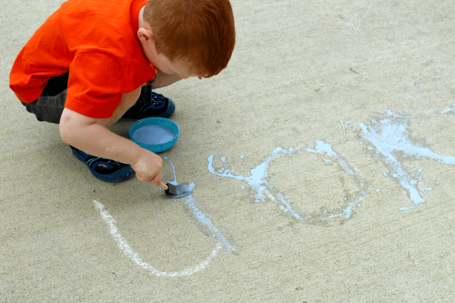 Learn to write letters of the alphabet with chalk.