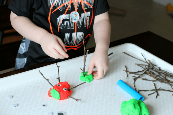 Make creatures with sticks, play dough and googly eyes!