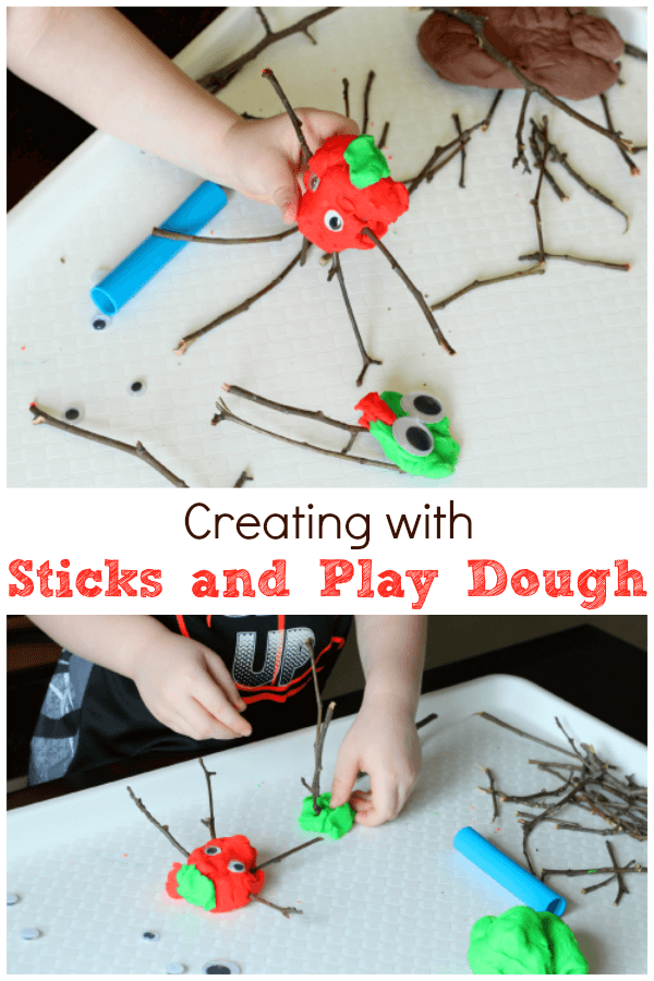 Invite kids to create with sticks and play dough!