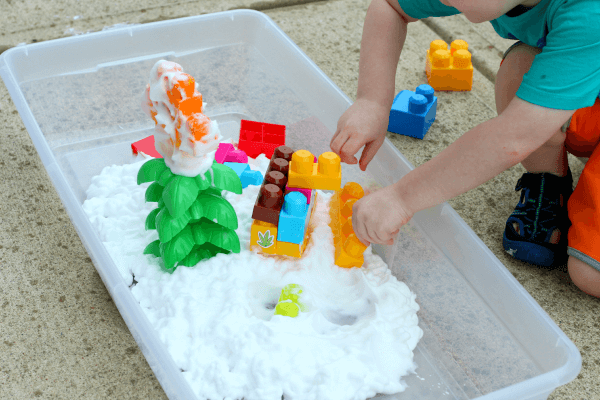 Build with blocks in shaving cream and you can make a castle in the clouds!