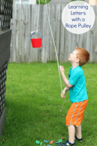 Preschool alphabet activity with a rope pulley. A STEM activity and introduction to simple machines.
