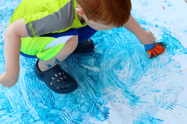 Use bathtub paint on a shower curtain and you have a fun sensory art experience for kids!