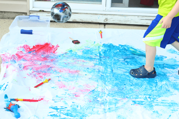 Bouncing balls in paint. A fun art experience for preschoolers!