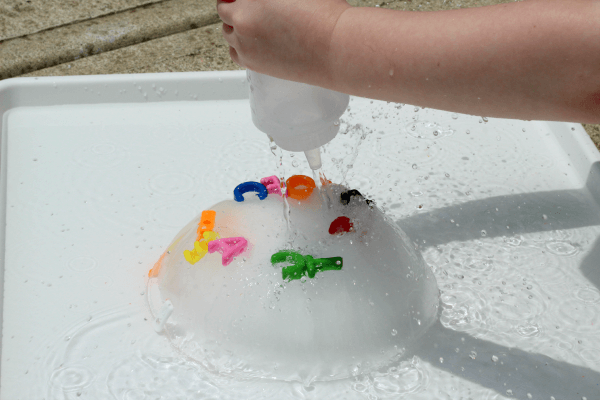 Ice excavation that teaches simple science and literacy concepts.