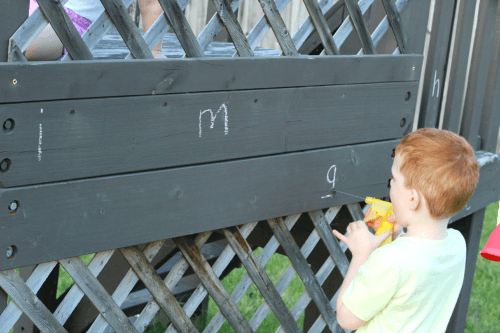 Write letters with chalk and spray them with a spray bottle!