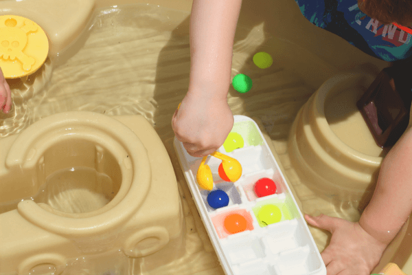 Using squeezers and balls to develop fine motor skills in preschoolers