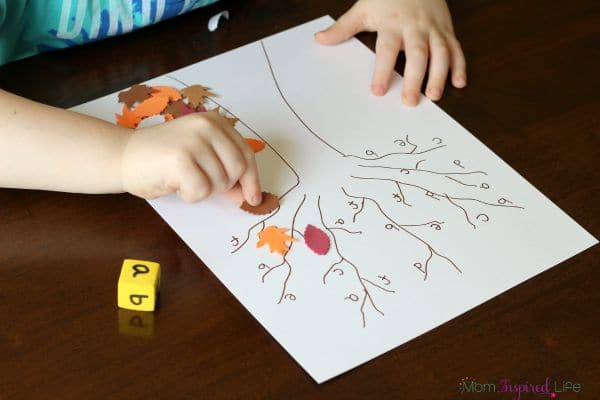 Cover alphabet letters on the tree with fall leaves. A fun roll and cover preschool game!