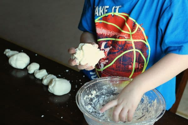Form clay into egg shape to form dinosaur eggs.
