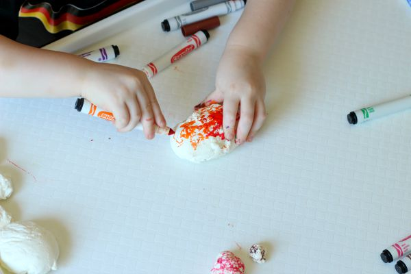 Color on clay with markers to make this dinosaur eggs craft.