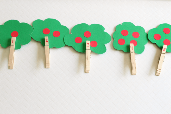 Learn to count with this fun apple tree fine motor activity.