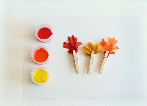Add clothespins to fall leaves and paint with fall leaves. A fall process art activity for preschoolers and toddlers.