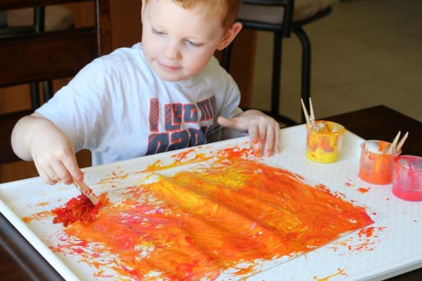 Painting with fall leaves process art.