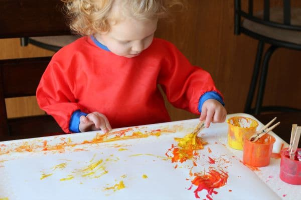 Fall process art for toddlers. Painting with fall leaves!
