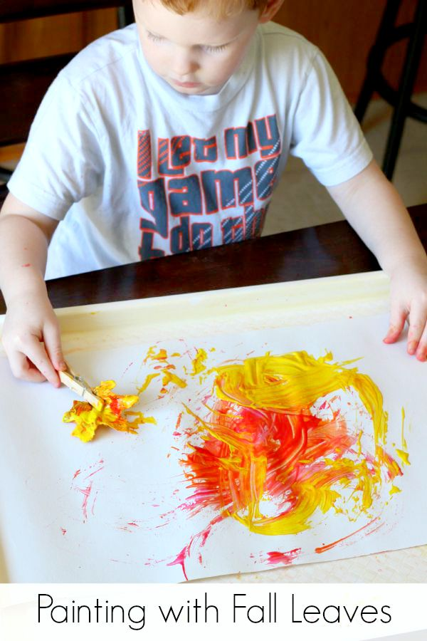 Fall process art activity for toddlers and preschoolers. Painting with fall leaves and using fall colors.